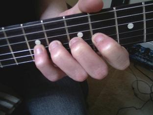 4th finger guitar vibrato technique