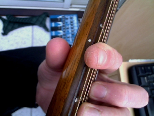 top view of thumb and index finger to increase strength when playing a barre chord