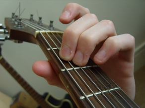 photo of E minor open guitar chord