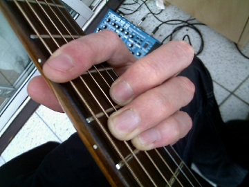 photo of E shape chord from guitarist's POV