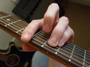 photo of the minor E shape chord from guitarist's POV