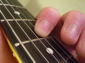 photo showing index finger fretting G string