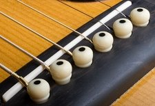 acoustic guitar bridge with bridge pins