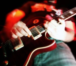 photo of guitar player on stage