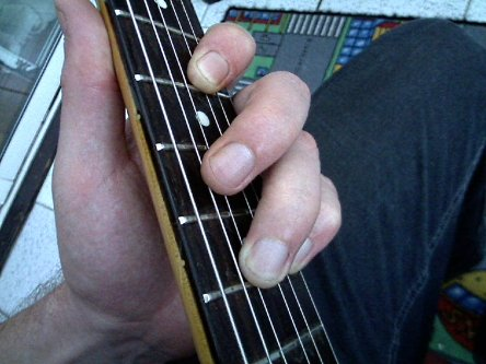 muting the 5th string using middle finger