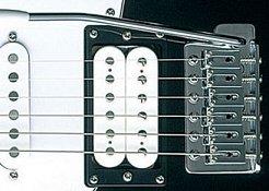 electric guitar bridge with tremolo arm