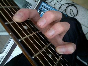 photo of cut down G shape barre chord