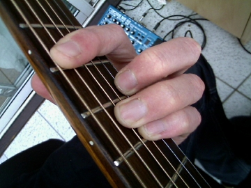 photo of the minor A form barre chord