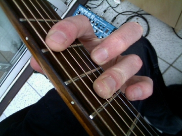 photo showing fingering for the A barre chord with barred 3rd finger