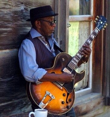 guitarist playing blues chord progressions