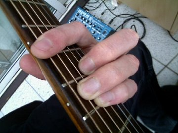 photo of E shape major barre chord from guitarist's POV