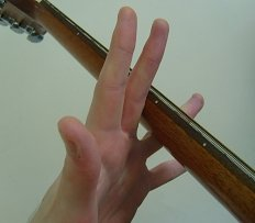 finger stretches using the guitar neck