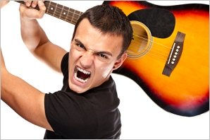 angry guitarist ready to smash his guitar